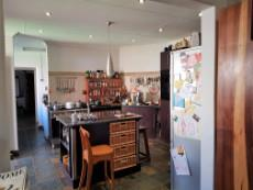 Kitchen with gas stove and separate scullery