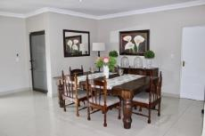 Open-plan formal dining area situated opposite lounge