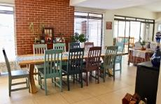 Open-plan dining area with facebrick feature wall