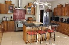 Teak kitchen with pantry, scullery and laundry