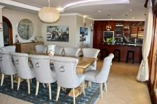 Open-plan formal dining area and kitchen