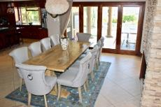 Open-plan formal dining area with gas fireplace and access to covered patio