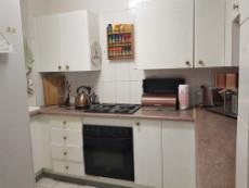 Kitchen with under counter oven & hob