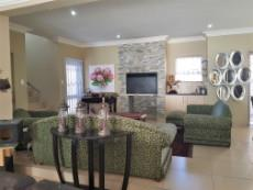 Warm entrance into the open plan living areas with braai room...