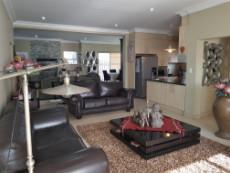 Open plan living areas with lounge, kitchen, dining- and braai room