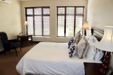 Main bedroom with seating area and air-conditioner