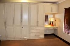 4th Bedroom built-in cupboards and dressing table