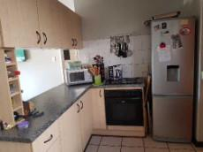 Kitchen with under counter oven, hob & space for large, single fridge
