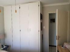 Guest bedroom with built-in-cupboards