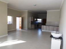 Dining & Living Areas, beautiful Kitchen at back (front door on left).