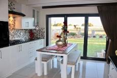 Kitchen with folding doors to garden and views of green area