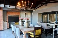Informal dining area with built-in braai and bar area