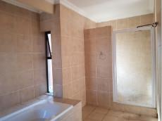 Full main-en-suite with bath & shower