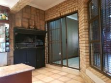 Built-in-braai with sliding doors in the entertainment area