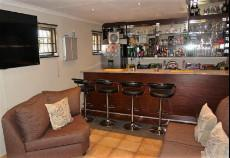 Enclosed entertainment area with bar and built-in-braai