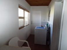 1st Floor:  Laundry  -  accessed via 3rd Living Area (=BBQ Room).