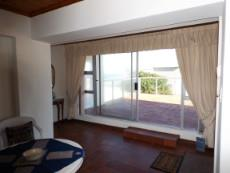 1st Floor: 4th Living Area - accessing Balcony (on side of ocean).