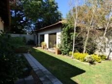 Cottage in pretty garden setting