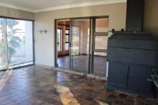 Entertainment area with sliding doors to family room and lounge