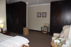 Main bedroom with his-and-hers closets
