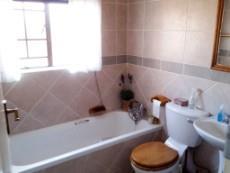 Bathroom with bath, basin and toilet