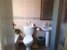 Bathroom with shower, bath, basin and toilet