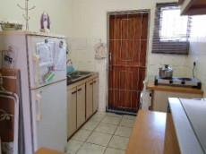 Kitchen with space for large single fridge