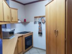Kitchen with under counter oven & hob & pantry cupboard