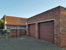 Double garage, one automated, one with isolated ceiling & sliding doors