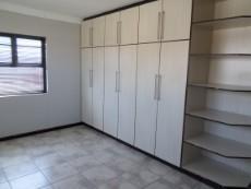 built in cupboards in bedroom