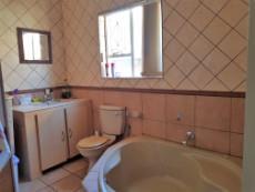 Main en-suite bathroom with corner bath, basin & toilet