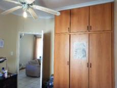 Main bedroom with built-in-cupboards & en-suite bathroom