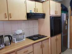Kitchen with eye level oven, hob & extractor