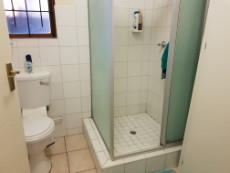 Main-en-suite with shower, basin & toilet