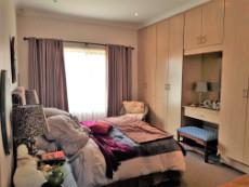 Main bedroom with built-in-cupboards & dresser