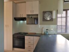 Kitchen with under counter oven, hob & extractor