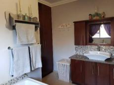 Main-en-suite with basin & linen cupboard