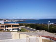 View to our left;  Gansbaai harbour & Birkenhead Peninsula at back.