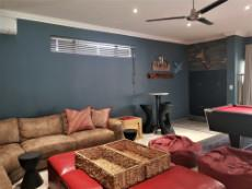 Family/TV room with and indoor built-in-braai