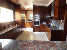 1st Floor: Kitchen (from Dining Area);  Scullery/Laundry at back.