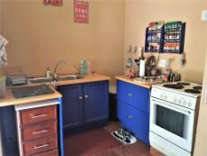 Loose stove included, space for top loader washing machine & dishwasher