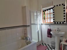 Full bathroom with black & white square patterns