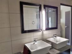 Full main-en-suite bathroom with double basins