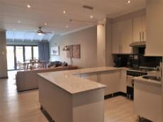 Kitchen with SMEG gas stove with electric oven & extractor