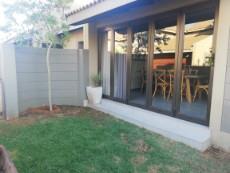 Stacker doors from the braai room flowing to the garden