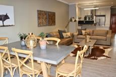 Open plan dining area, lounge and kitchen