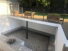 Outdoor entertainment area with upper garden