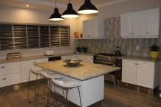 Kitchen with new 900mm gas stove, scullery and pantry