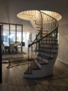 Classic, spiral staircase in entrance hall