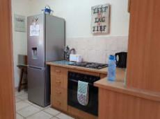 Under counter oven & hob & space for single large fridge
